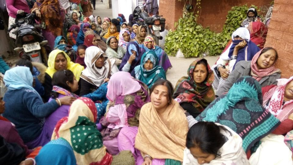 Family members mourn the death of 58-year-old Singh,  who was said to be under pressure, as he was allegedly being harassed by his seniors.