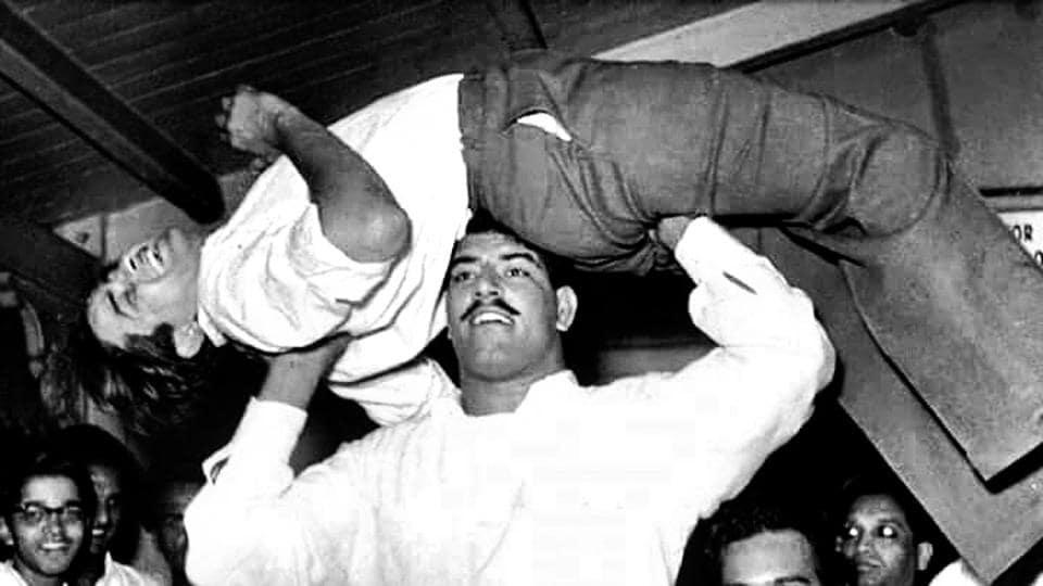 Dara Singh lifting Raj Kapoor in his famous aeroplane spin.