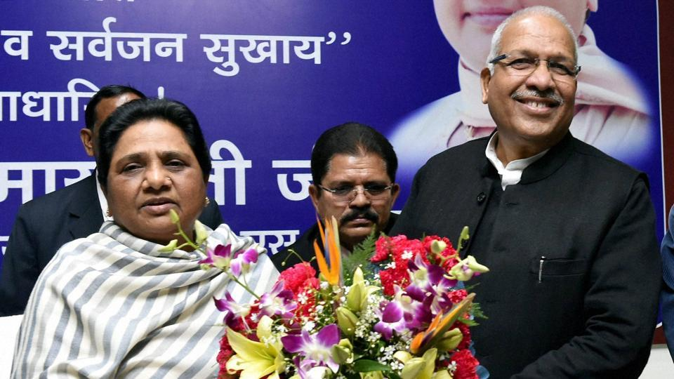 Ambika Chaudhry (R)  joins BSP in the presence of party supremo Mayawati (L) at the party office in Lucknow on Saturday.