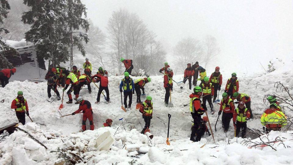 Rescuers work in the area of the avalanche-hit Rigopiano hotel, central Italy, on Saturday. After two days huddled in freezing cold, tons of snow surrounding them in the wreckage of the hotel, survivors greeted their rescuers Friday as