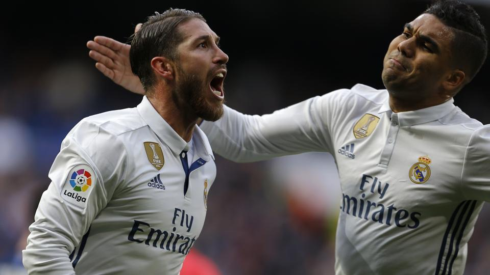 Real Madrid CFbeat Malaga CF 2-1 in their La Liga encounter thanks to two goals from Sergio Ramos.