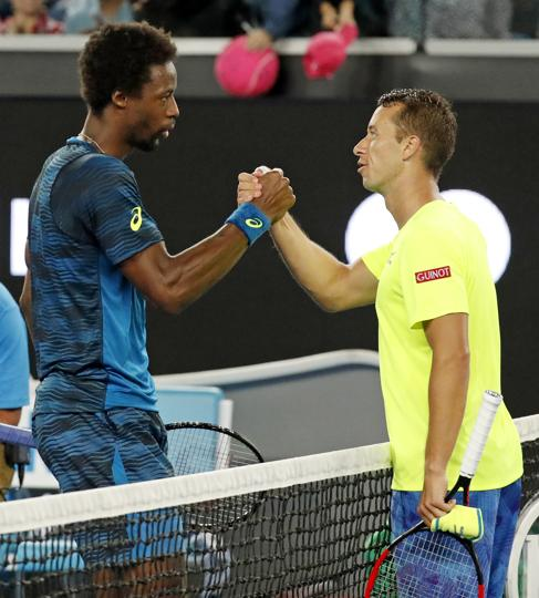 Gael Monfils (left) is congratulated by Germany's Philipp Kohlschreiber. Monfils won the Rd 3 match 6-3, 7-6 (7/1), 6-4. (AP)