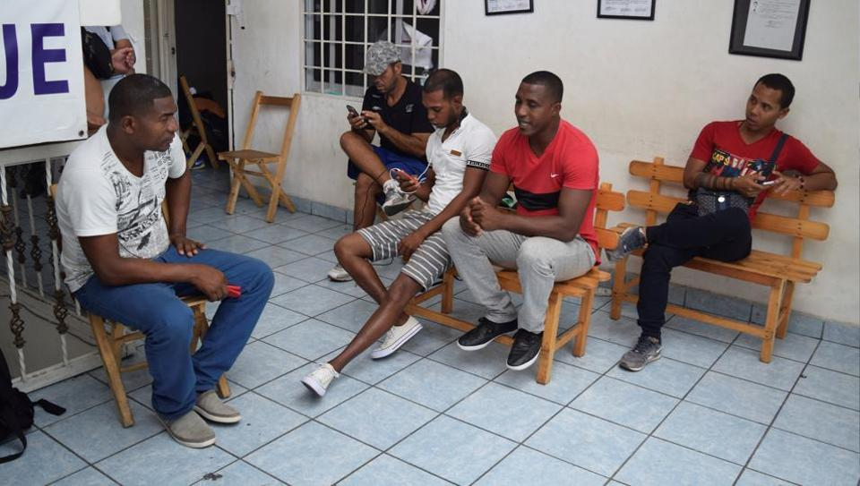 Cubans stranded in Mexico chat at a hotel after fellow nationals were deported in Tapachula, Mexico on January 20, 2017.