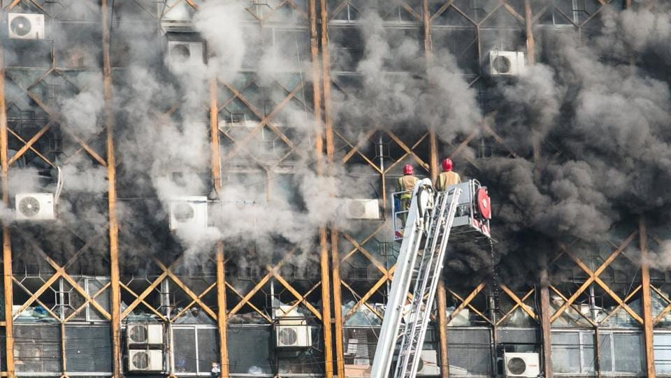 Firefighters try to put out fire  at the oldest high-rise building in Tehran, Iran. (REUTERS)