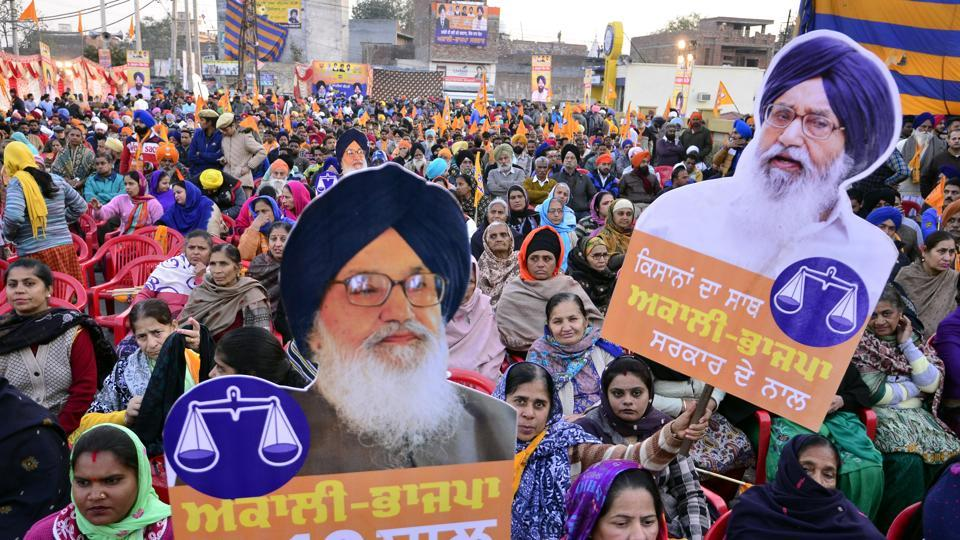 AkaliBJP supporters holding chief minister Parkash Singh Badal's cutouts at a political rally in Amritsar on Friday. Deputy CM Sukhbir Singh Badal addressed the event that was organised in support of SAD's Amritsar South candidate Gurpratap Singh Tikka.