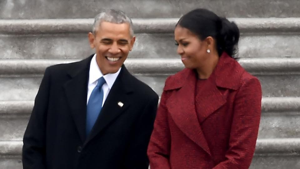 Former president Barack Obama with wife Michelle on the front steps of the US Capitol after Donald Trump's inauguration as the new US president on January 20, 2017 in Washington, DC.