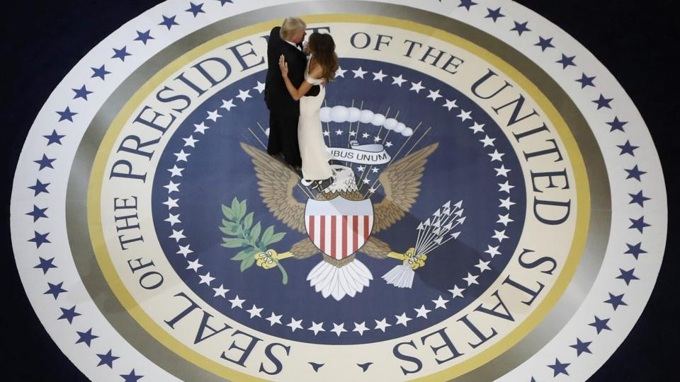 US President Donald Trump and his wife, first lady Melania Trump, dance at the