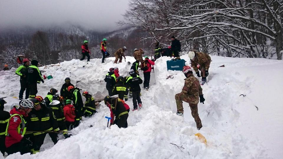 Rescuers work in the area of the hotel that was hit by an avalanche on Wednesday, in Rigopiano, central Italy, Jan 20.