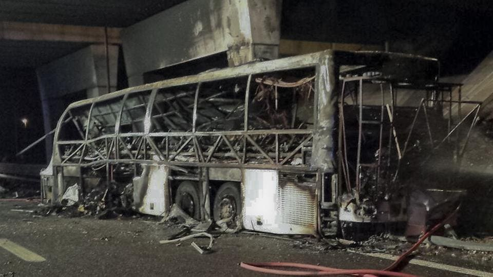 Firefighters spray water on the burnt bus that crashed and burst into flames near Verona in northern Italy on Friday night. Police say 16 people died when the bus carrying Hungarian students returning home from France met with an accident.