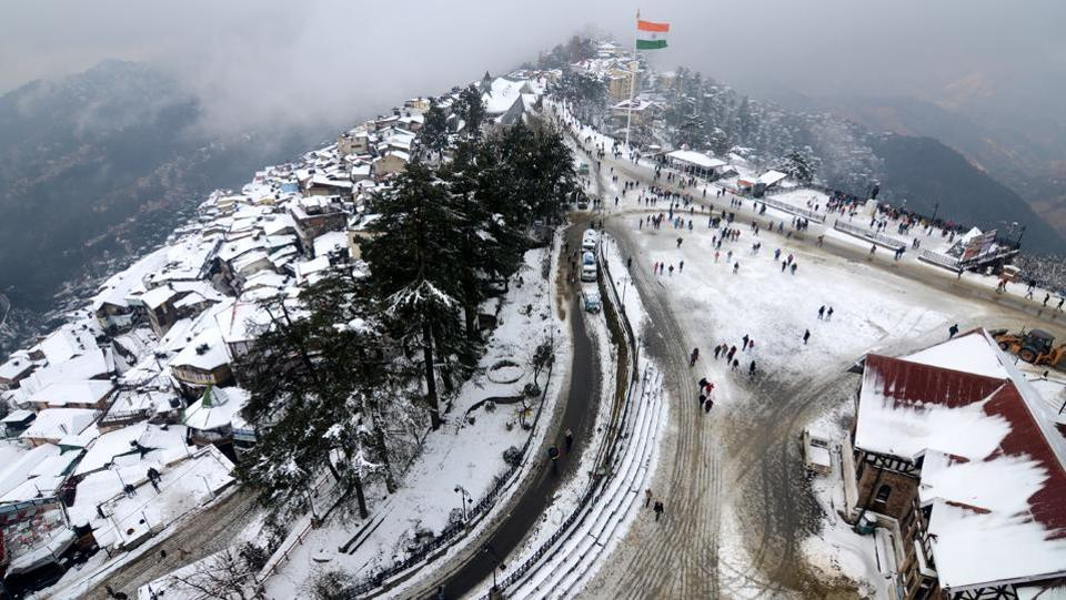 An aerial view of a snow covered city and Ridge after Shimla received a second spell of snow. (Deepak Sansta/HT Photo)
