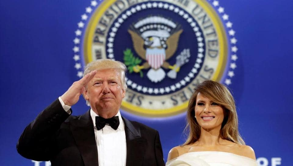 US President Donald Trump salutes with his wife Melania at the Armed Services Ball in Washington on Friday.