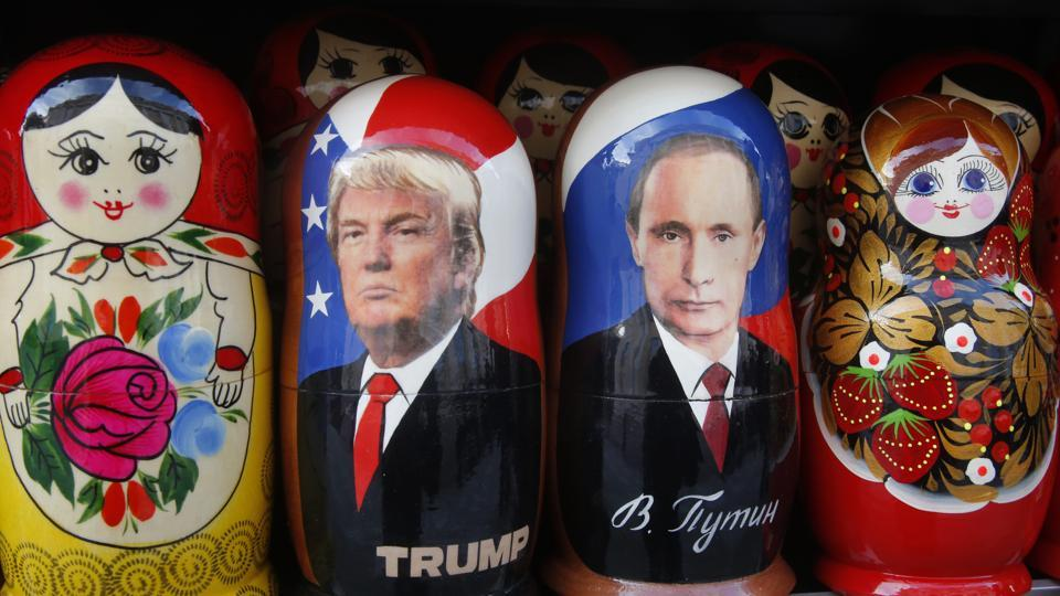 Traditional Russian wooden dolls called Matryoshka depicting Russian president Vladimir Putin and US president Donald Trump displayed at a street souvenir shop in Russia.