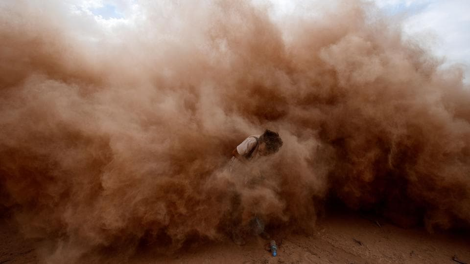 A photographer is pictured during Stage 11 of the 2017 Dakar Rally between San Juan and Rio Cuarto, in Argentina. (Franck Fife/AFP)