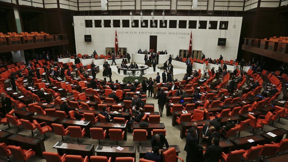 Legislators in Turkey's parliament debate proposing amendments to the country's constitution on Jan 20.