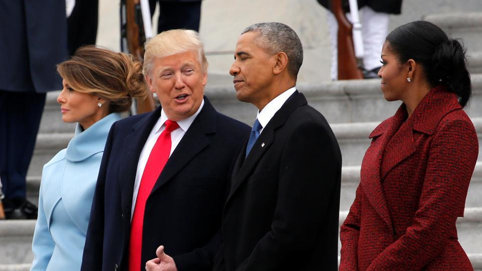 US President Donald Trump and first lady Melania Trump see off their predecessors Barack and Michelle Obama as they depart following Trump's inauguration at the Capitol in Washington.
