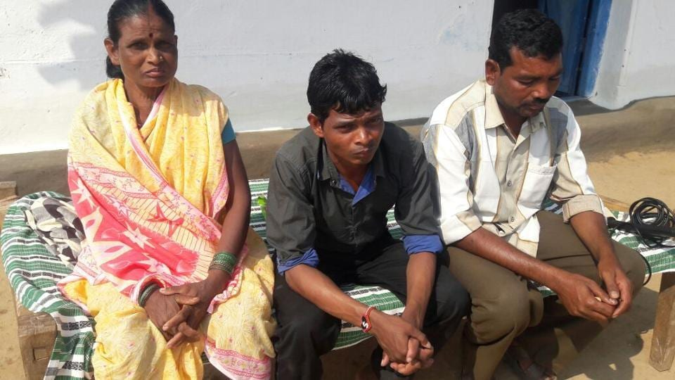 Sunil Uike (centre) with his mother and brother in Balaghat district on Saturday.