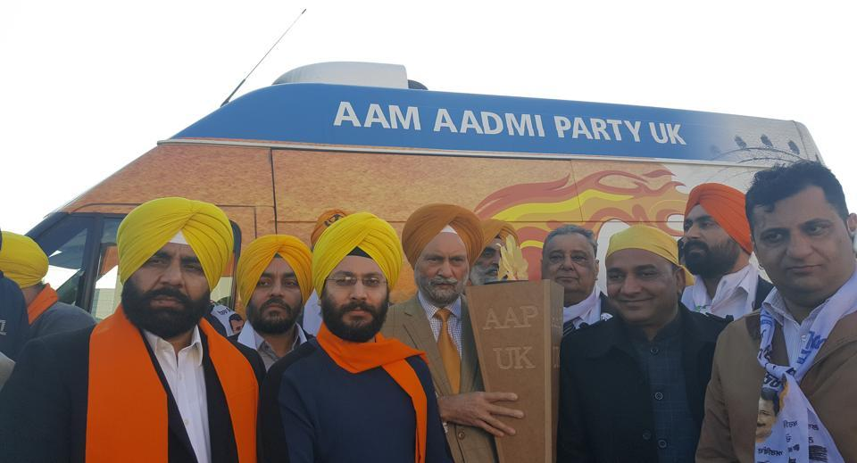 Leaders and supporters of AAP UK hold the 'Flame of Hope' at the Sri Guru Singh Sabha in Southall, London, before embarking on a one — mile walk in support of the party on Sunday.
