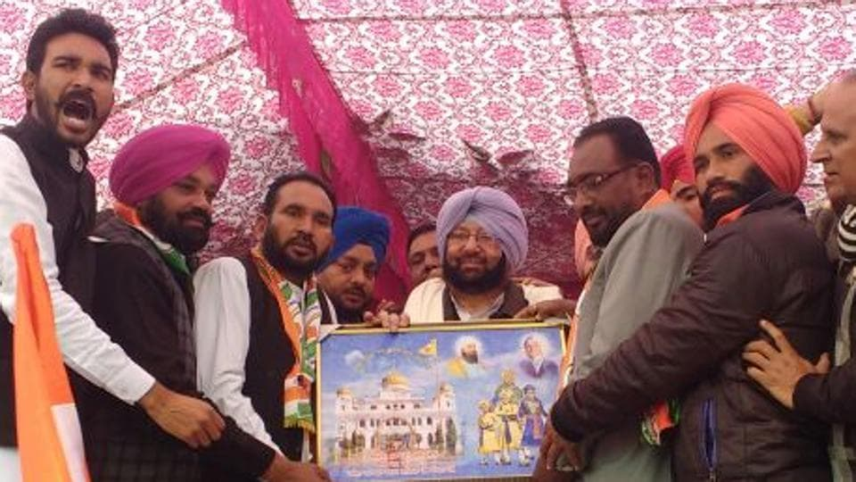 Captain Amarinder Singh being honoured at a poll meeting in Lambi segment on Saturday.