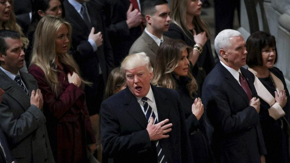 US President Donald Trump sings the National Anthem during a National Prayer Service at the National Cathedral, in Washington.