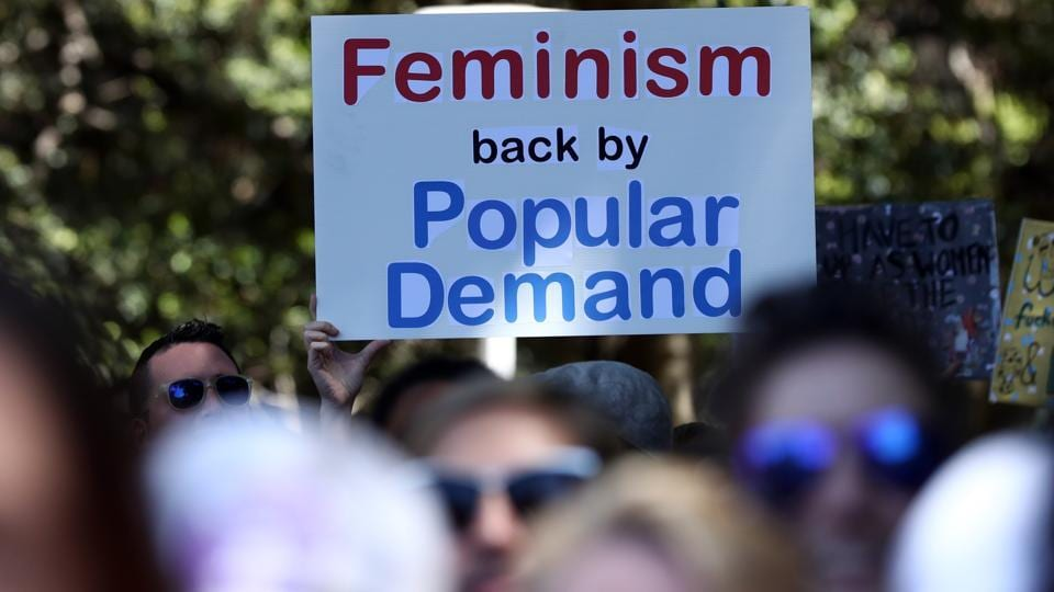 Women protestors march in a rally against US President Donald Trump following his inauguration, in Sydney on January 21.