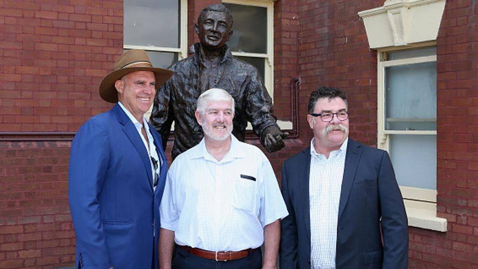 Australian Cricket Hall of Fame inductees Matthew Hayden (left) and David Boon (right) with side Ken Wilson, nephew of Betty Wilson, at Sydney Cricket Ground on Sunday.
