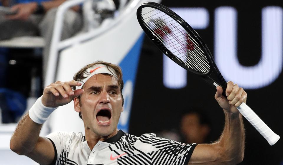 Roger Federer celebrates his win over Kei Nishikori during their fourth round match at the Australian Open.