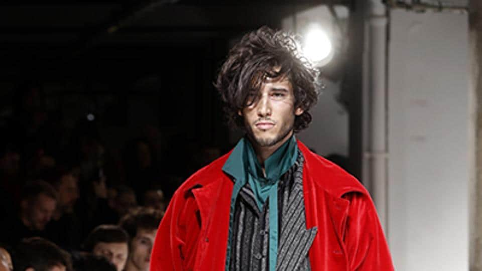 Colourful long-length coats were also a key trend at Yohji Yamamoto, brightening up more traditional tailoring. (AFP)