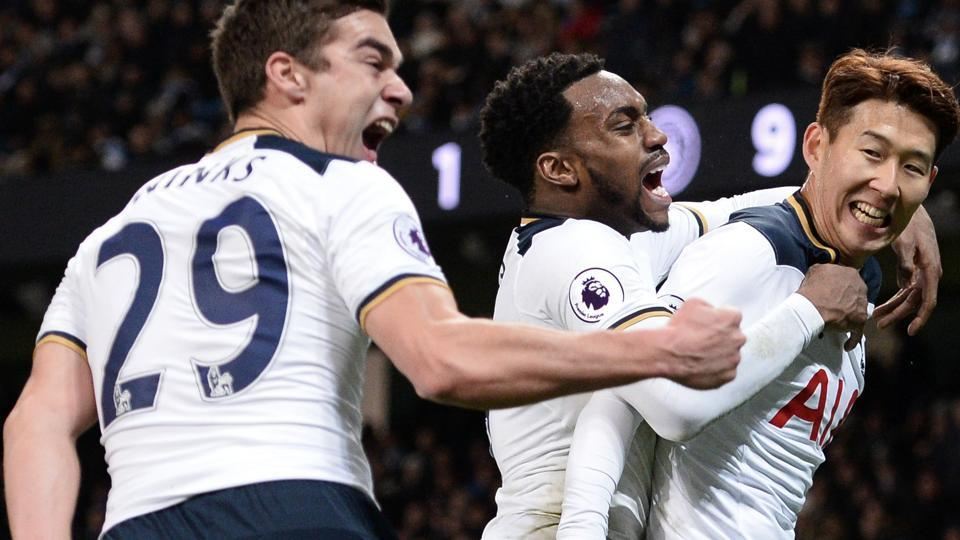 Tottenham Hotspur's South Korean striker Son Heung-Min (R) celebrates with midfielder Harry Winks (L) and defender Danny Rose (C) after scoring their second goal during the English Premier League match against Manchester City at the Etihad Stadium in Manchester.