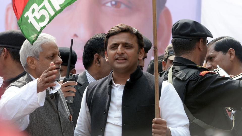 This file photograph taken on February 23, 2014,shows India's Uttar Pradesh state Chief Minister Akhilesh Yadav holding a flag bearing his Samajwadi Party symbol as he flags off a bicycle rally in New Delhi.