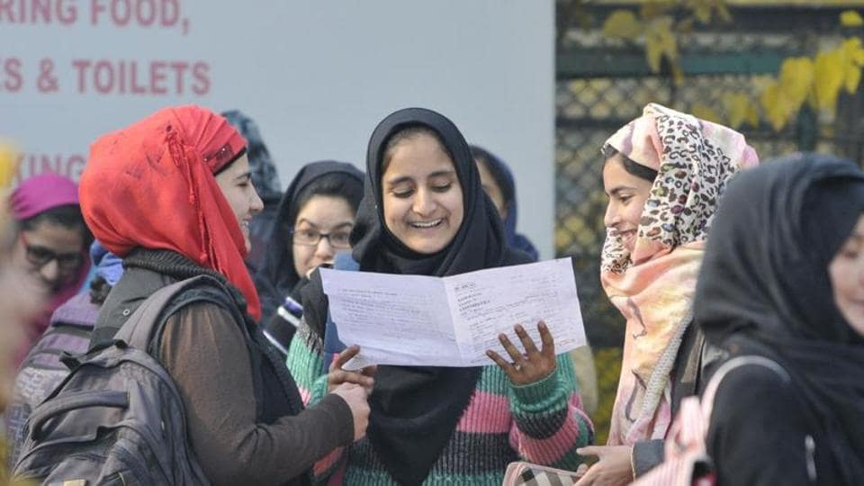 Kashmiri students leave an examination centre after appearing for higher secondary school exams in Srinagar in November 2016.