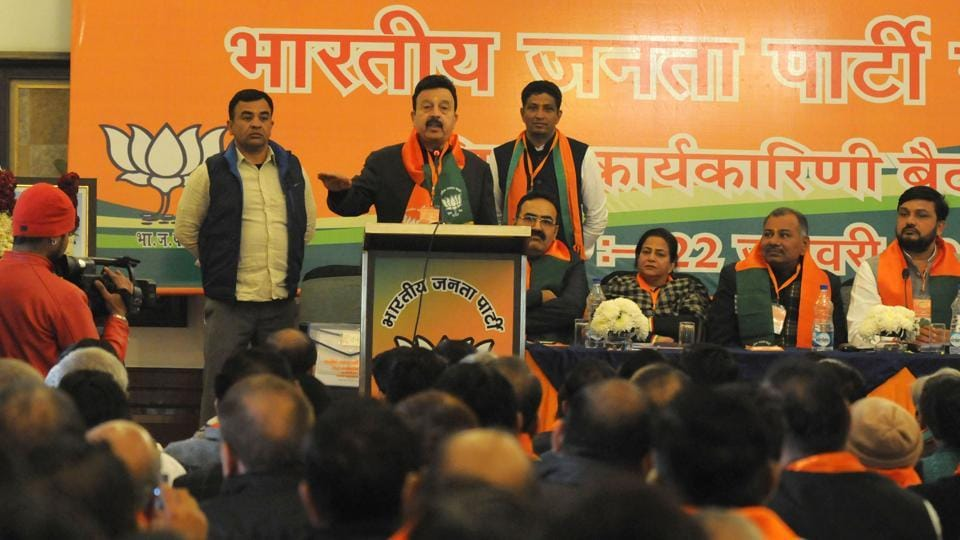 Cabinet minister Rao Narbir Singh speaks at BJPdistrict executive meeting at South City-2 in Gurgaon on Sunday.
