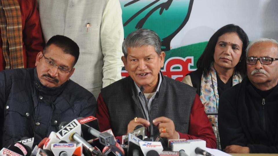 CM Harish Rawat (C) and state Congress president Kishore Upadhyay (L) are among the senior leaders to get party ticket.