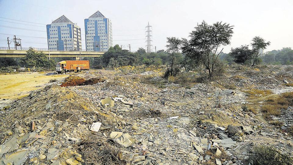 Construction waste dumped at a vacant space near Huda City Centre.