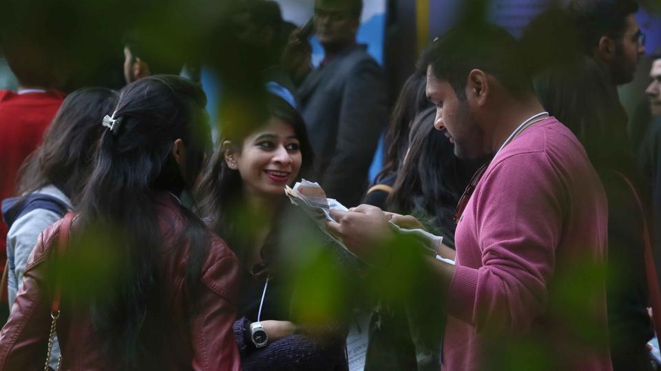 Visitors checking the day's schedule at the Jaipur Literature Festival on Sunday.