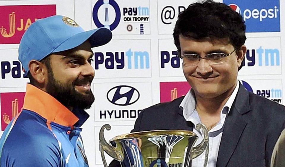 India captain  Virat Kohli receives the ODI series winner's trophy from Sourav Ganguly at the Eden Gardens in Kolkata.