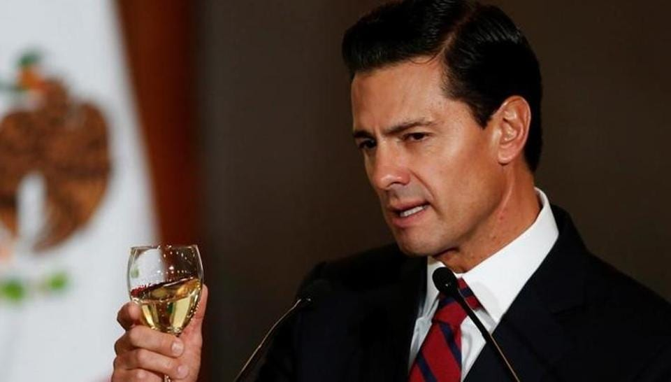 Mexico's President Enrique Pena Nieto makes a toast during a meeting with members of the diplomatic corps in Mexico City.