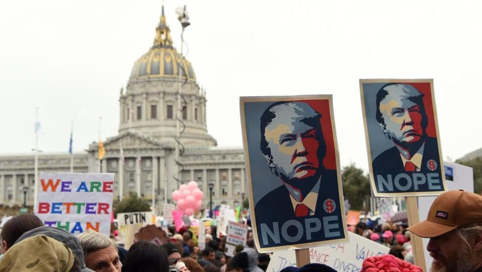 Thousands of people gather at City Hall to protest President Donald Trump and to show support for women's rights in San Francisco on January 21, 2017. Hundreds of thousands of protesters spearheaded by women's rights groups demonstrated across the US to send a defiant message to US President Donald Trump.
