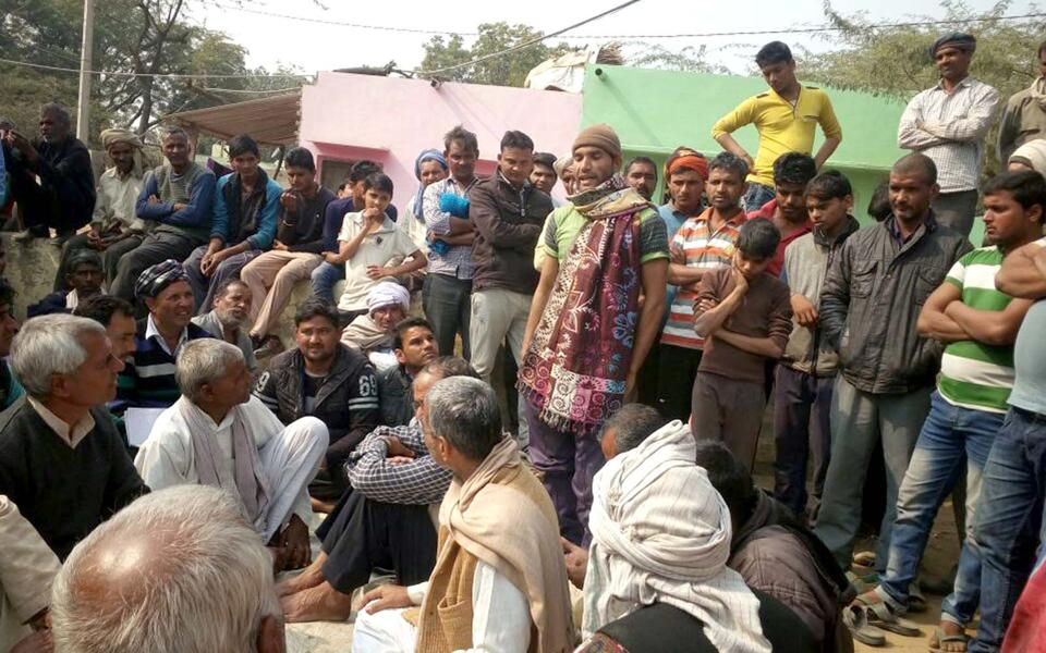 Villagers attend a panchayat meeting in  Surota village to ban sale and consumption  of liquor.
