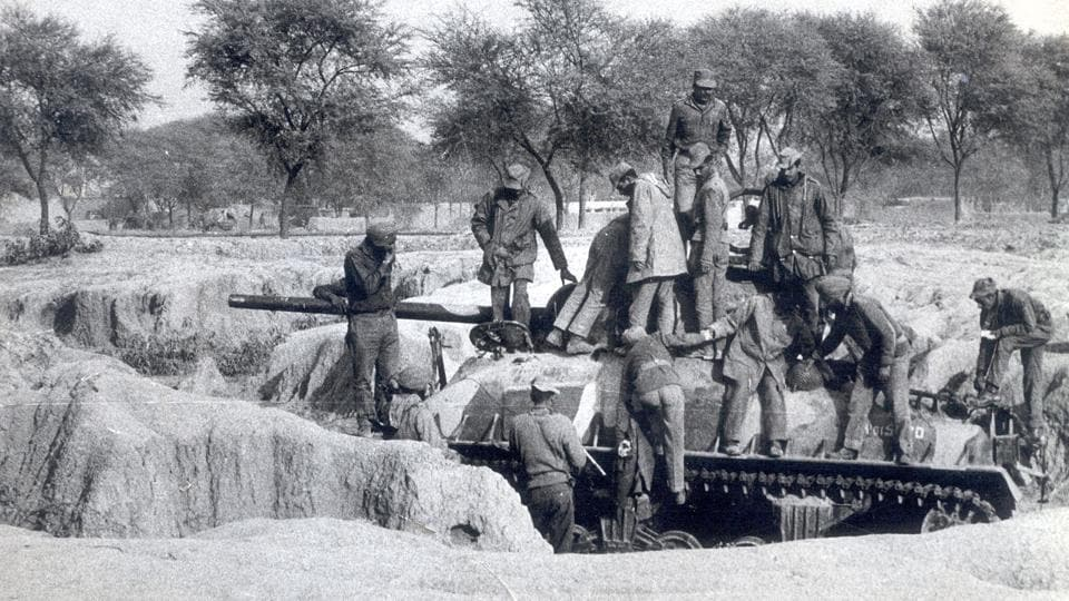 Soldiers investigate a Pakistani damaged tank during the 1971 war. At the time, India had neither confirmed nor denied crossing the border before the war broke out.