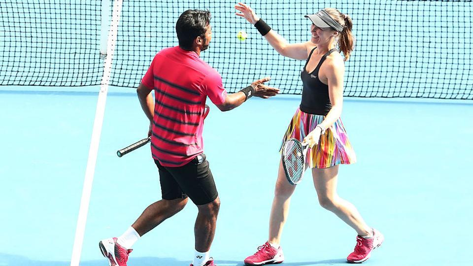 Martina Hingis of Switzerland and Leander Paes celebrate after beating Casey Dellacqua and Matt Reid of Australia at the Australian Open on Monday.