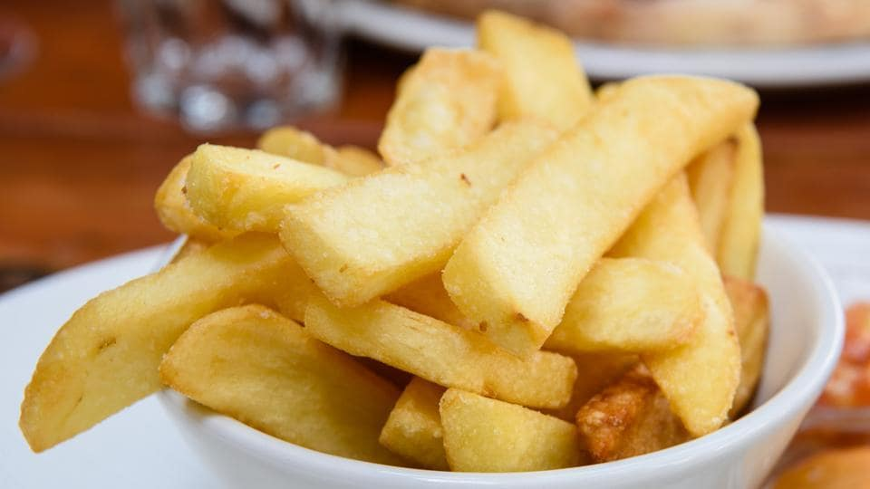 Bread, chips and potatoes should be cooked to a golden yellow colour, rather than brown, to reduce our intake of a chemical which could cause cancer, government food scientists are warning.
