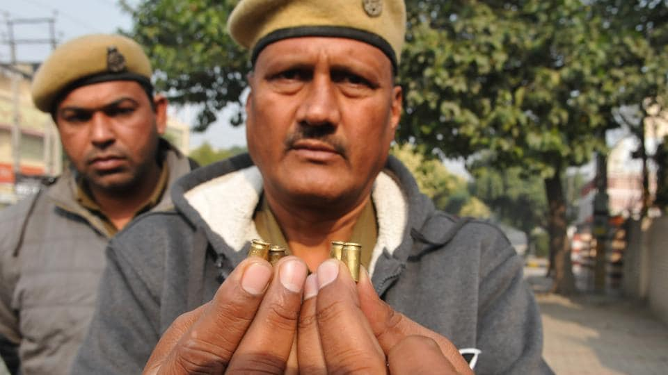 A police official showing shells recovered from shootout  spot in Jalandhar.