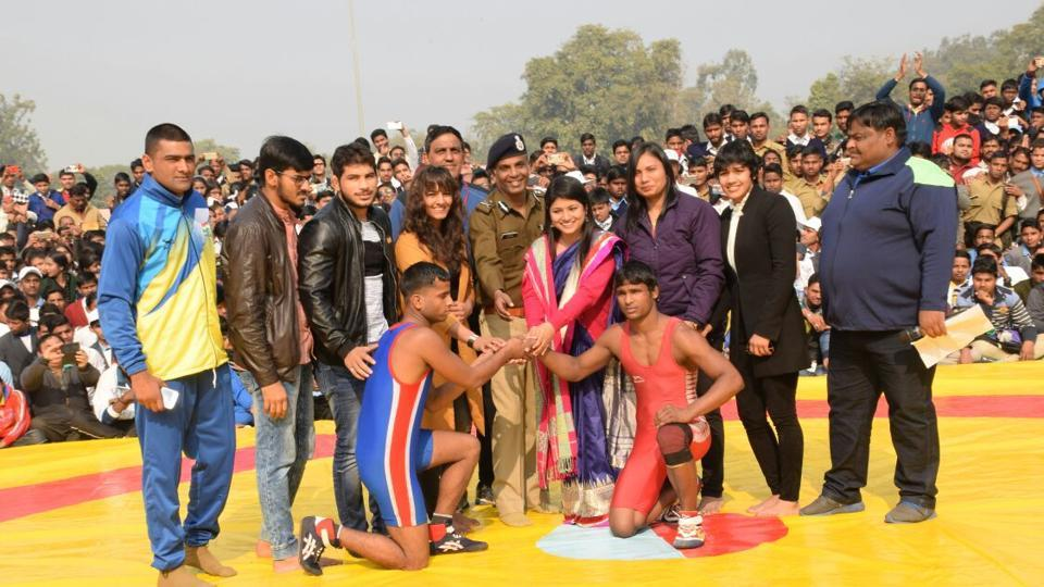 Geeta and Babita Phogat with Alka Tomar at the 'dangal' in Meerut on Sunday.