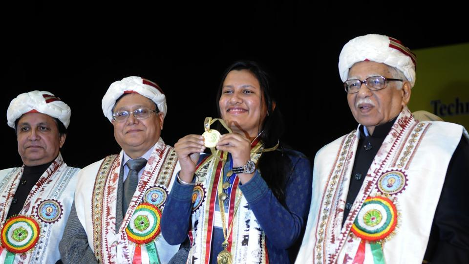 UP Governor Ram Naik and Padma Bhushan VK Saraswat giving away AKTU's first Chancellor Gold Medal to Ayushi Agarwal in Lucknow on Monday. Ayushi is a student of Ajay Kumar Garg Engineering College, Ghaziabad.