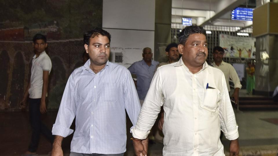 AAP MLA Gulab Singh (L) was arrested on charges of extortion from Gujarat.