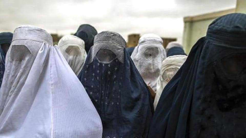 A woman in a niqab was targeted by an Australian woman who demanded to know if there was a gun being hidden under the traditional garb.