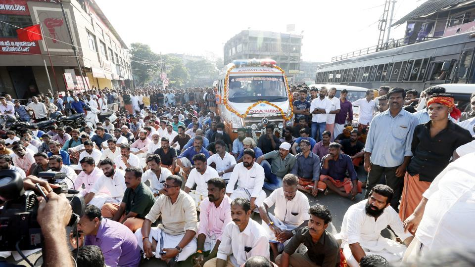 The slain BJP worker's body taken out in a procession in Kannur on Thursday. Police defused tension allowing agitated workers to display body at the heart of the city.