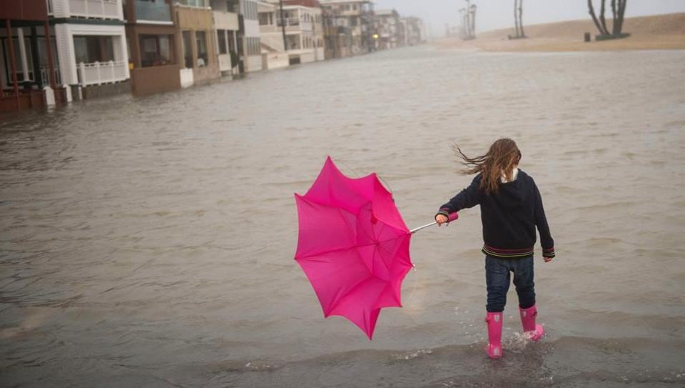 Isabella Busse , 6, walks through floodwater near the Seal Beach Pier during a storm in Seal Beach, Calif., Sunday, Jan. 22, 2017. The heavy downpour on Sunday drenched Orange County in one of the heaviest storms of the year.