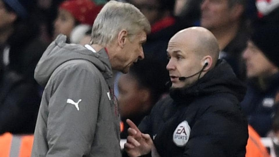 Arsenal manager Arsene Wenger clashes with fourth official Anthony Taylor before being sent to the stands during his team's Premier League match against Burnley.