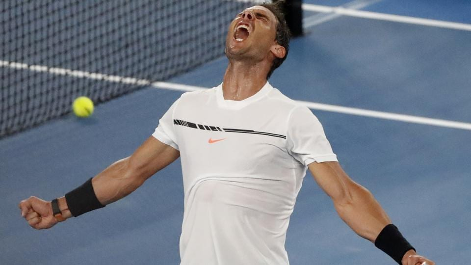 Rafael Nadal celebrates after defeating France's Gael Monfils in their fourth round match at the Australian Open.